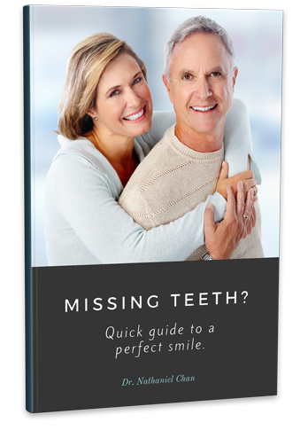 Book on Treating Missing Teeth with Dental Implants in Quincy & Norwell, MA