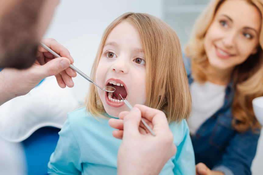 """""""Kid Getting her Teeth Treated at a Children's Dentistry Service in Quincy and Norwell, MA """" Dentist in Quincy and Norwell"""