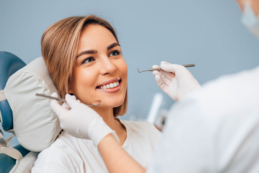Cosmetic Dentist Treating a Patient